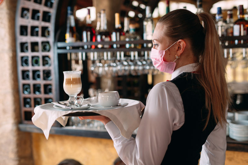 Waitress wearing face mask COVID